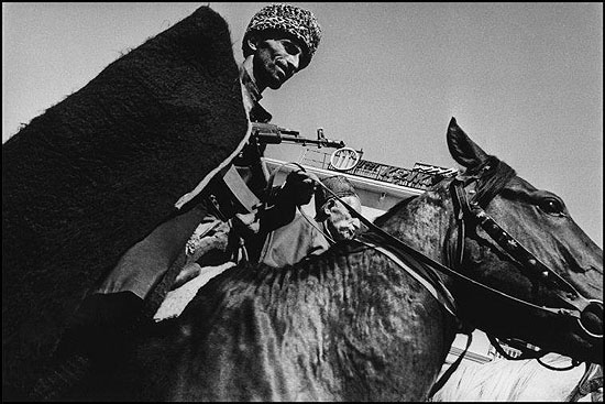 © Thomas Dworzak / Magnum Photos, 09/1994. Grozny. Chechen Independence Day celebrations. Military parade and horse races.