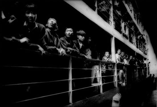 "James Whitlow Delano: ""Empire: Impressions from China: Empire #002: Peasants crowding the rails of a river steamer. Three Gorges, Yangtze River"", (1997) Archival pigment print on fine art paper. 32cm x 44.6cm; 57cm x 79cm; 100cm x 139cm. Edition of 25., © James Whitlow Delano. Courtesy of m97 Gallery."