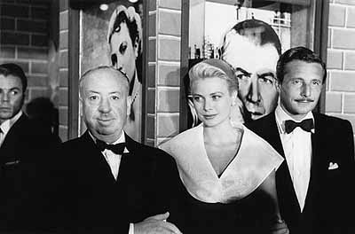 Alfred Hitchcock, Grace Kelly and Oleg Cassini at the premiere ofRear Window, 1954