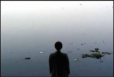 A Laundry Woman, 2000, video still from performance, Yamuna river, Delhi