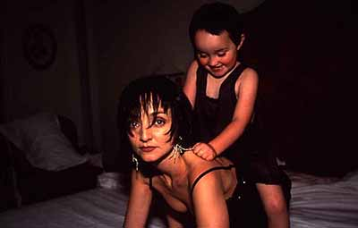 Julia sitting on Maria's back, Paris, 2001