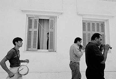 Nikos Economopoulos: Mesologi, Gipsy musicians in the feast of St. Simeon, Greece, 2003. 62.6x82.6cm. © Magnum Photos