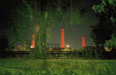 Patrick Zachmann: Friday, June 13, 1 a.m., Gazi, the former gasworks, Athens, Greece, 2003. 56.8x83.9cm © Magnum Photos