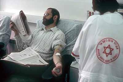 Jean MohrGiving blood at the Magen David Adom centre in Jerusalem 2002