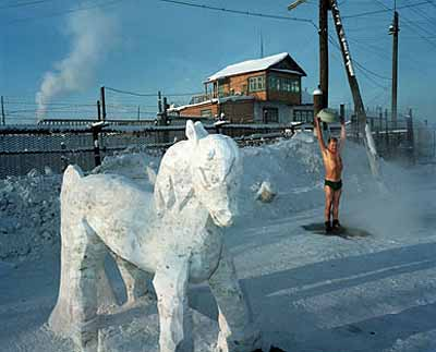 Carl De KeyzerPrisoner demonstrates resistance to temperatures of -50C by taking a shower © Magnum Photos