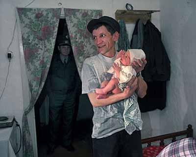 Carl De KeyzerPrisoners' village: birth of baby © Magnum Photos