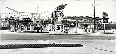 Knox Less, Oklahoma City, Oklahoma, from the series TwentySix Gasoline Stations, 1962 Gelatin silver print 4 15/16 x 10 9/16 in. Whitney Museum of American Art, New York; Purchase, with funds from The Leonard and Evelyn Lauder Foundation, and Diane and Thomas Tuft 2004.479 © Edward Ruscha