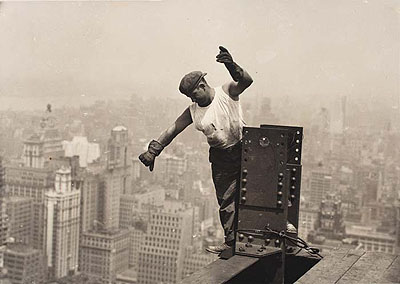 Lot 111: Lewis W. Hine, Empire State Building, worker signaling on high beam, silver print, 1930. Estimate: $10,000 to $15,000.