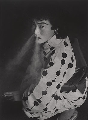 Shomei Tomatsu,  Prostitute, Nagoya, 1958, printed 2003; gelatin silver print; 13 7/8 x 10 3/16 in.; promised gift of Al Alcorn to the San Francisco Museum of Modern Art; C Shomei Tomatsu