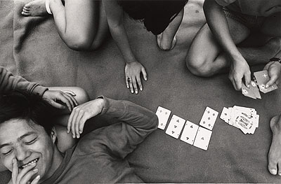 Shomei Tomatsu, Card Game, Zushi, Kanagawa, 1964, printed 1980; gelatin silver print; 8 1/4 x 12 9/16 in.; private collection; C Shomei Tomatsu