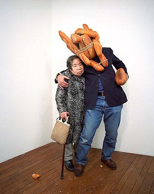Tatsumi Orimoto . Bread Men  1991/2007colour photograph53,9 x 36 cm courtesy: DNA, Berlin www.dna-galerie.de