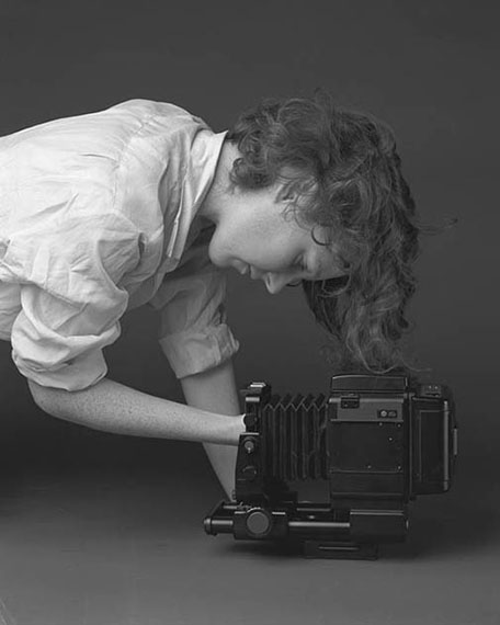 Philipp Dorl: Girl with Hand in Camera, 2011