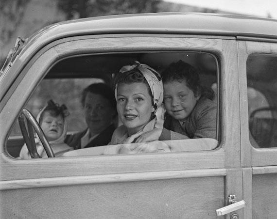 Rita Hayworth with her daughters Rebecca and Yasmina leaving Château de l'Horizon, property of Aly Khan. Golfe-Juan, 1951