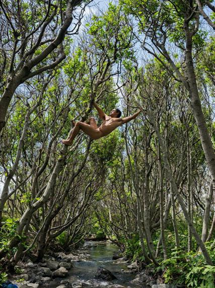 Matt Swinging Between Trees, Lost Coast, California. © Lucas Foglia, courtesy Michael Hoppen Gallery