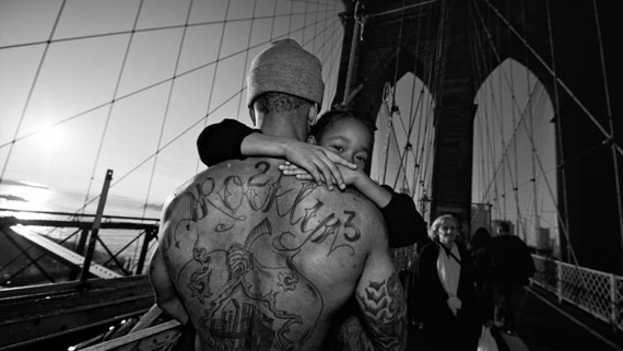 Jerell Willis carrying Fidel over the Brooklyn Bridge. Brooklyn, NY. November 2012.Digital print on archival paper, 20x28 inches.© Zun Lee