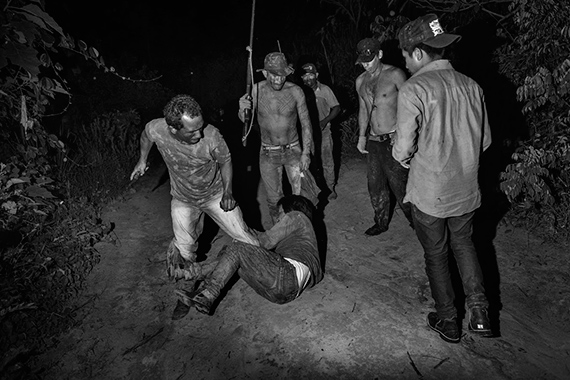 Araribóia, Maranhão. Members of the Guajajara forest guard patrolling the Araribóia indigenous reserve in Maranhão State beat another indigenous man whom they suspect of collaborating with illegal loggers. © Tommaso Protti for Fondation Carmignac