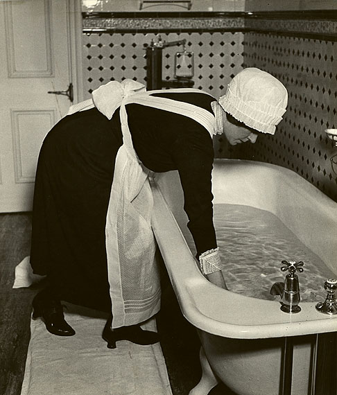 Parlourmaid Preparing a Bath Before Dinner, c. 1937© Bill Brandt Archive Ltd.Courtesy Edwynn Houk Gallery