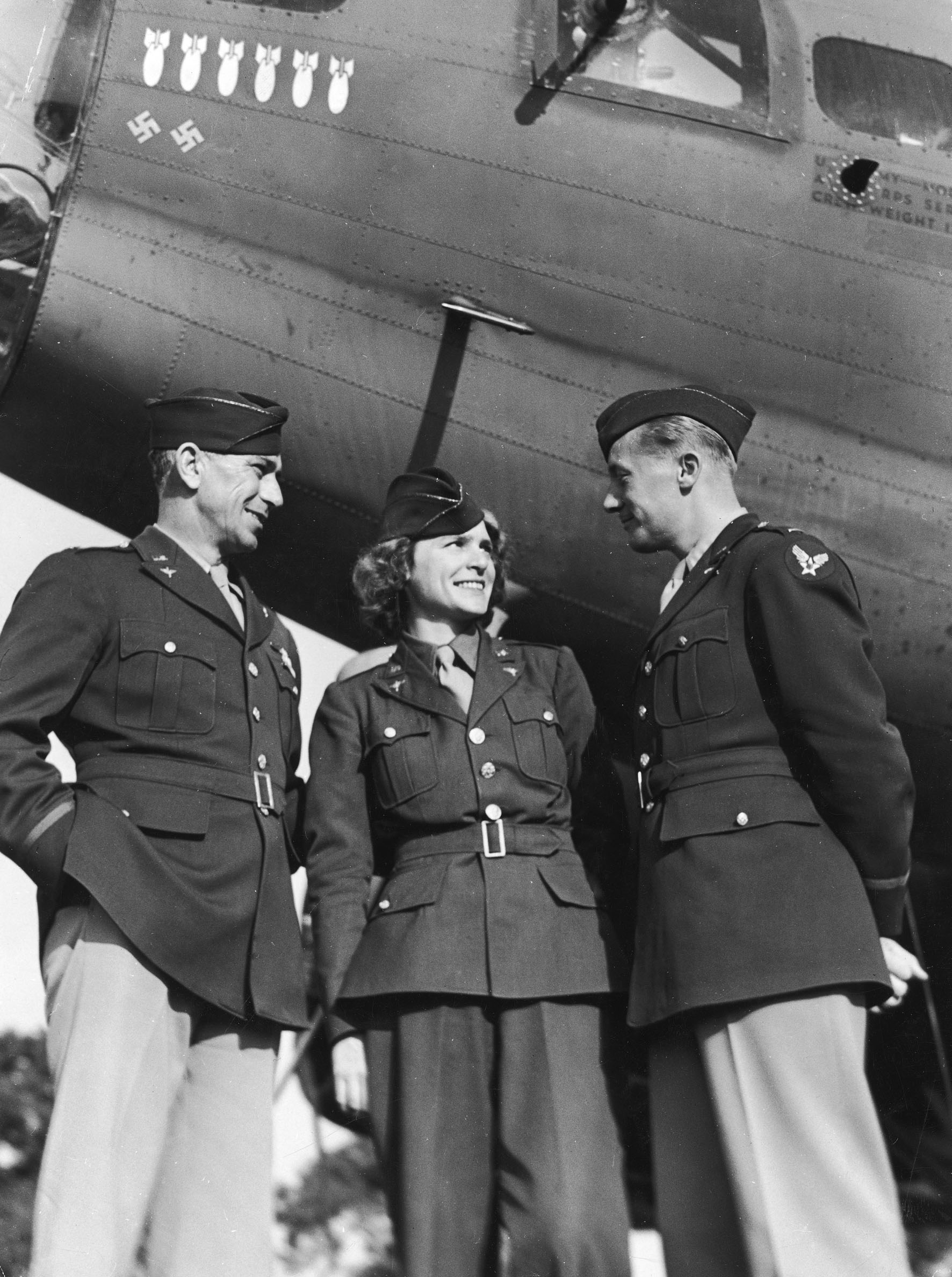 Margaret Bourke-White in an Air Force uniform with officers of the 8th Bomber Command