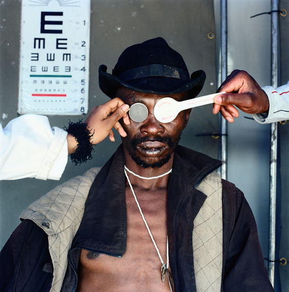 "Mikhael Subotzky""Joseph Dlamini (Eye test)"", Matsho Tsmombeni squatter camp, 2012"