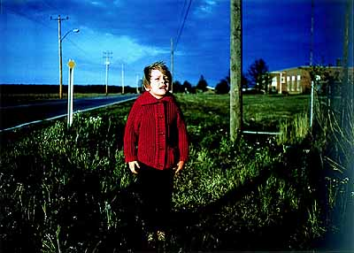 William Eggleston, Untitled (Boy in Red Cardigan) 1971, Dye-transfer print, 323 x 450 mm, credit: Pinakothek der Moderne, Munich, Siemens artsprogram, Dauerleihgabe der Siemens Aktiengesellschaft © 2003 The Eggleston Artistic Trust