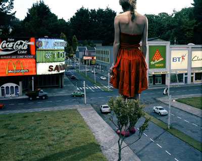 Julia Fullerton-Batten, Red Dress in City, 2005 © Fullerton-Batten
