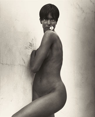 HERB RITTS (American, 1952-2002)Stephanie with Flower, 1989Gelatin silver, 1989Paper: 19-3/4 x 16 inches (50.2 x 40.6 cm)Image: 18-1/4 x 15 inches (46.35 x 38.1 cm)Edition: 12/25Recto: blind stamped (c) Herb RittsVerso: signed, titled, dated, and numbered in pencilState: hinged at top with archival tape to mat and framed