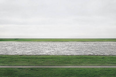 ANDREAS GURSKY (B. 1955) Rhein II signed 'Andreas Gursky' (on a paper label affixed to the backing board) chromogenic color print face-mounted to Plexiglas image: 73 x 143 in. (185.4 x 363.5 cm.)overall: 81 x 151a x 2 in. (207 x 385.5 x 6.2 cm.)Executed in 1999. This work is number one from an edition of six.© ANDREAS GURSKY, COURTESY OF CHRISTIE'S
