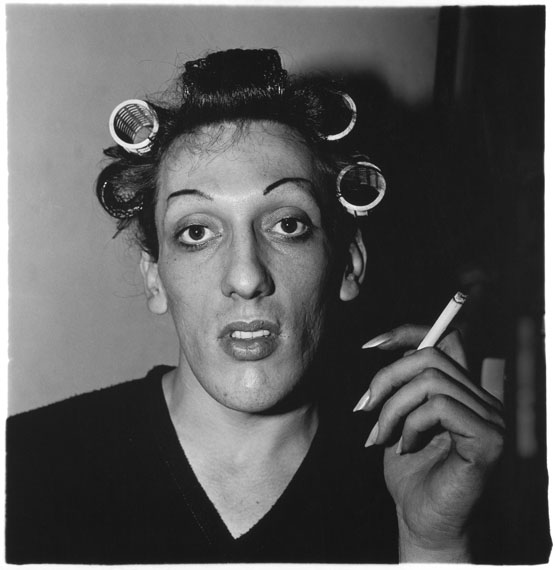 Diane ArbusA young man in curlers at home on West 20th Street, N.Y.C. 1966© The Estate of Diane Arbus