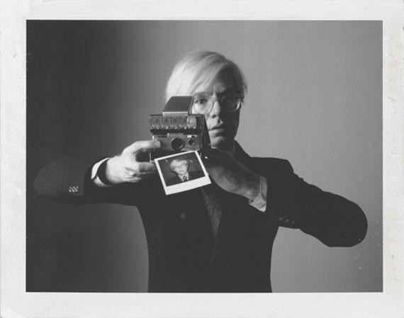 Oliviero ToscaniAndy Warhol with camera1974, Polaroid Type 1053. x 4.