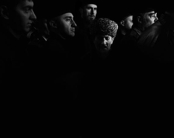"Republic of Chechnya, Russia, 03/2013. A group of men leaving the Akhmad Kadyrov Mosque, known as the ""Heart of Chechnya,"" following Friday prayers. Islam, long suppressed in Chechnya, is now heavily promoted. In addition to commissioning the mosque that bears his father's name, Ramzan Kadyrov declared that under his rule, Chechnya would be ""more Islamic than the Islamists."" Grozny. © Davide Monteleone /VII for Carmignac Gestion Photojournalism Award"