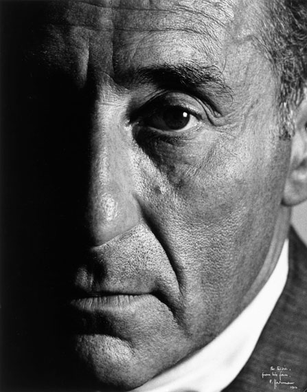 """Philippe HalsmanPORTRAIT OF ALFRED EISENSTAEDT.1962Vintage. Gelatin silver print. (133/4x103/4in.). Dedication in white ink within the image, lower right: """"For Eisie, from his fan, P. Halsman, 1962"""". On the reverse the photographer's i.e. copyright stamp, the photographer's stamp, and other stamps."""