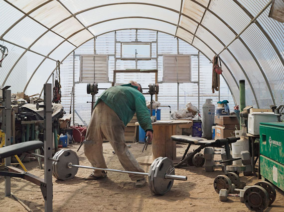 Roger Weightlifting, Jonah Natural Gas Field, Boulder, Wyoming 2010 © Lucas Foglia
