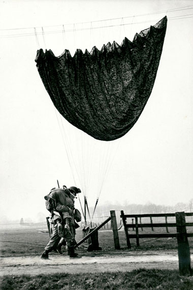 Robert Capa GI carries injured paratrooper to medical aid station during first Allied air drop behind enemy lines near Wesel, Germany, March 24, 1945 Gelatin silver print 13.38 х 8.88 in. Est. US$7,000–10,000
