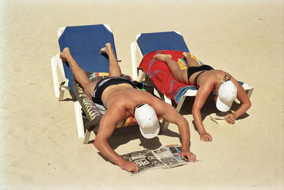 Sunbathing and reading on the beach. Magaluf, Majorca, Spain. 2003. © Martin Parr / Magnum Photos