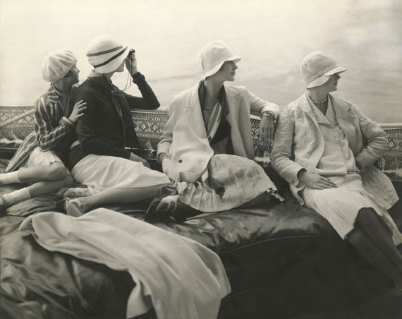 EDWARD STEICHENOn George Baher's yacht. June Cox wearing unidentified fashion; E. Vogt wearing fashion by Chanel and a hat by Reboux;Lee Miller wearing a dress by Mae and Hattie Green and a scarf by Chanel; Hanna-Lee Sherman wearing unidentified fashion. 1928© 1928 Condé Nast Publications