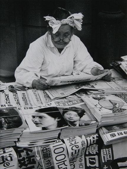 Toni SchneidersZeitungsfrau auf der Ginza Tokyo 1961 Silver Gelatin print, printed later 31 x 24 cm verso stamped and signed © Toni Schneiders Estate / Courtesy of Bernheimer Fine Art