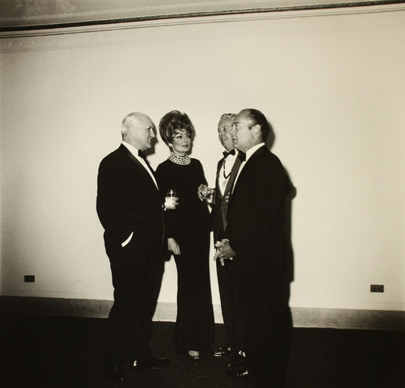 Diane Arbus Four People at a Gallery Opening, N.Y.C., 1968 Gelatin silver print printed later by Neil SelkirkEdition of 7515 х 14.5 in. Est. 8,000–10,000 USD