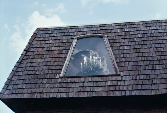 Lot 23William Eggleston (B. 1939)Untitled [chandelier in window], c. 1970dye-transfer printsigned in pencil and photographer's credit stamp (verso)image: 12 x 17.1/2 in. (30.5 x 44.5 cm.) sheet: 15.7/8 x 20 in. (40.4 x 50.9 cm.)$8,000-12,000