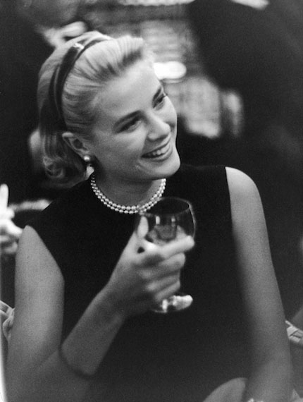 """Grace Kelly at a Cocktail Party given by Alfred Hitchcock for the Film """"To catch a Thief""""Château des Croix des Gardes, Cannes 1954, Vintage gelatin silver print© Edward Quinn Archive"""