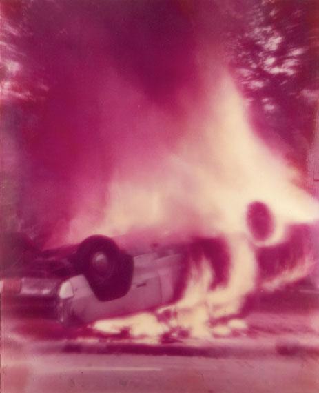 Alfons SchillingChicago Riot, Burning Car, 1970Lenticular photographCourtesy OstLicht Collection© Estate of Alfons Schilling