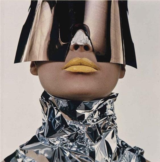 © Irving PennWoman with sun block, New York, 1966