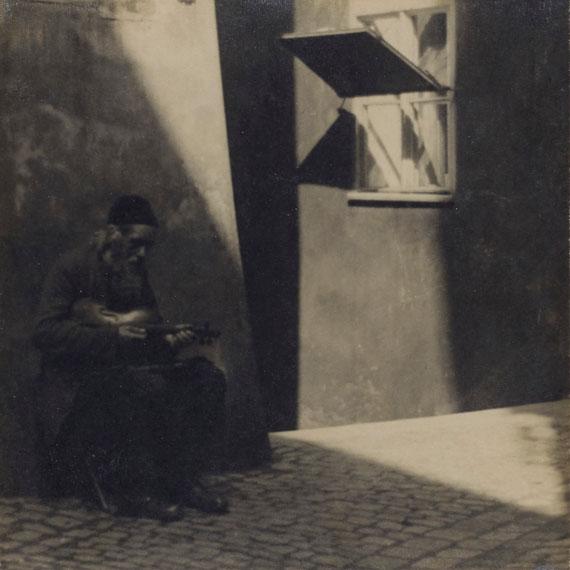 Lot 57JAROMIR FUNKE (1896-1945)Untitled (Man with a Violin), circa 1922-25Gelatin silver print, mounted on boardImage/sheet: 9¼ x 9¼ in.Mount: 19¼ x 18⅜ in.Estimate: €30,000 – 50,000
