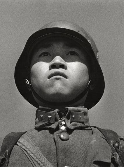 Robert Capa: Chinese boy soldier in helmet, 1938 © International Center of Photography / Magnum Photos