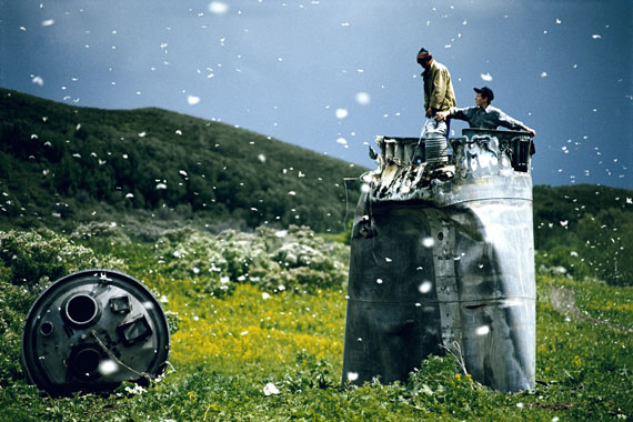 Villagers collecting scrap from a crashed spacecraft, Altai Territory, Russia, 2000© Jonas Bendiksen/Magnum Photos