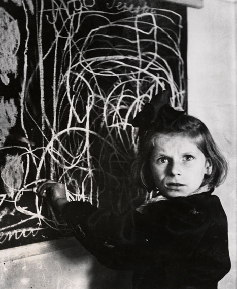 """Tereska standing by her drawing of """"home"""" in a home for emotionally disturbed children, Warsaw, 1948© Chim (David Seymour)  Magnum Photos  Courtesy Chim Estate"""