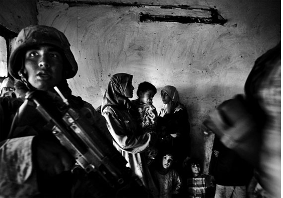 Anja NiedringhausUS Marines raid the house of an Iraqi delegate in the Abu Ghraib district, Baghdad, Iraq, November 2004 pigment print on baryte paper29,7 x 42 cmKunstpalast © picture alliance/AP Images