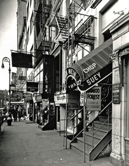 "© Berenice Abbott, ""Chop Suey, West 8th Street"", 1935–38"