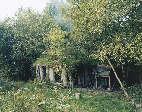 """David Spero: from """"SETTLEMENTS""""The big hut, Tir Ysbrydol, Brithdir Mawr, Pembrokeshire, October 2004Roundwood timber-frame hut with cob-rendered straw bale walls and turf-covered reciprocal frame roof. Constructed by Tao 2000© David Spero"""