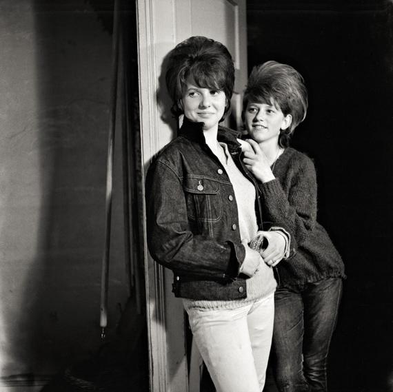 KARLHEINZ WEINBERGERTwo standing girls in the studioC. 196232 x 32 cmSelenium toned silver gelatin print© Karlheinz Weinberger, Courtesy Galerie Esther Woerdehoff