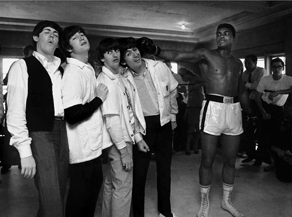 Harry Benson George takes a hit from Cassius Clay. 5th Street Gym. Miami1964©Harry Benson/ Courtesy Staley-Wise Gallery, New York